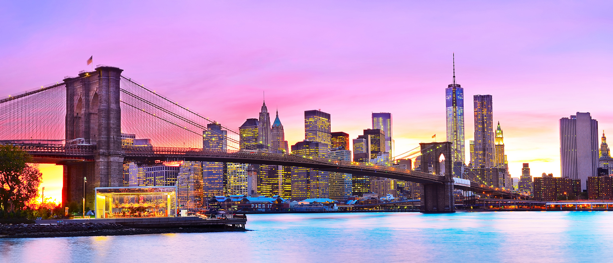 sunset with the Brooklyn bridge and NYC skyline in the background