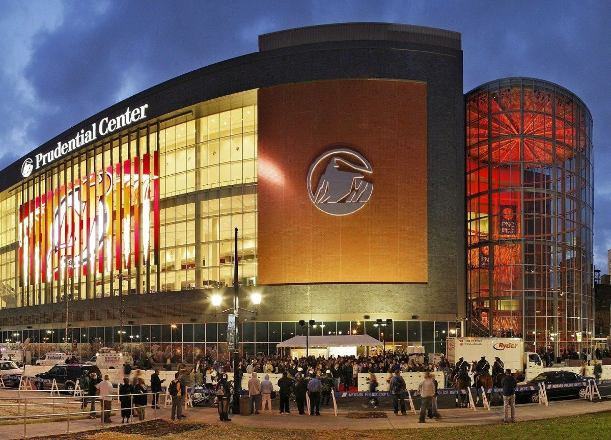 exterior pg Prudential Center at night displaying NJ Devils symbol