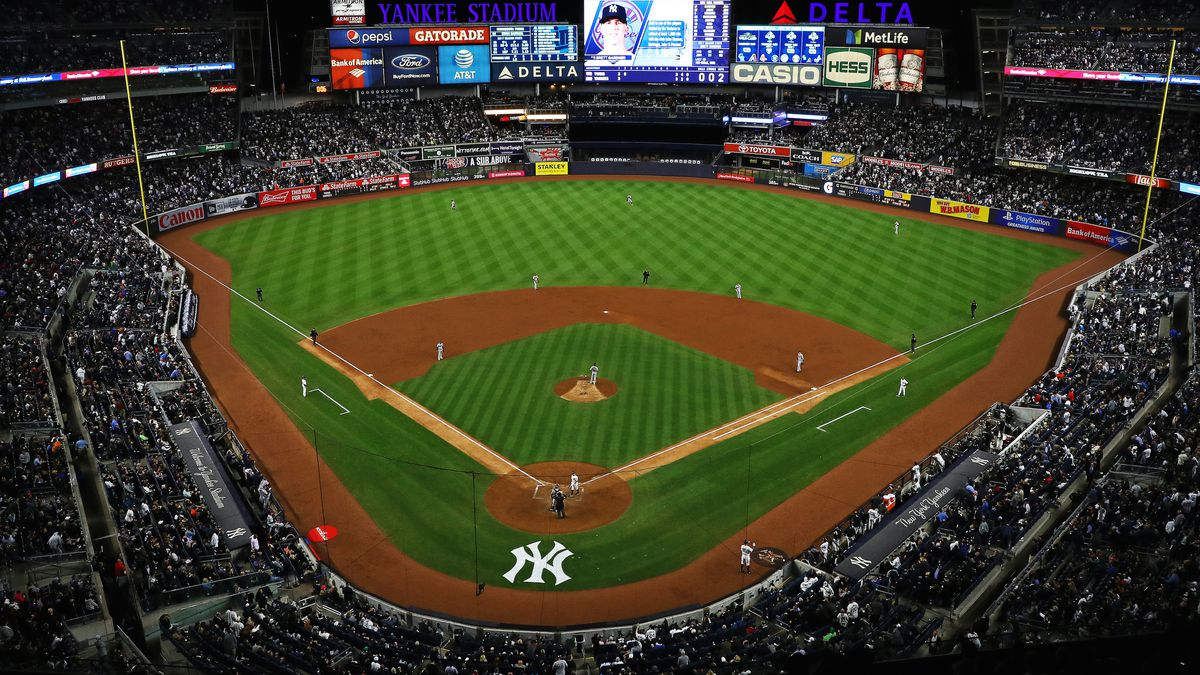 Yankee stadium baseball field surrounded by large crowd